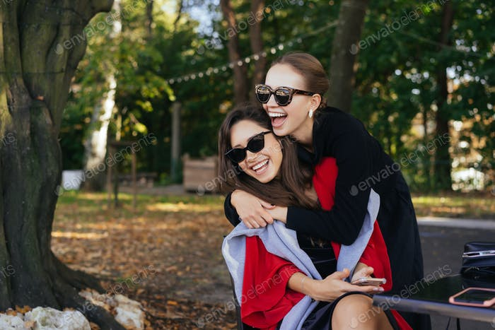 Girl hugging her friend. Portrait Two girlfriends in the park