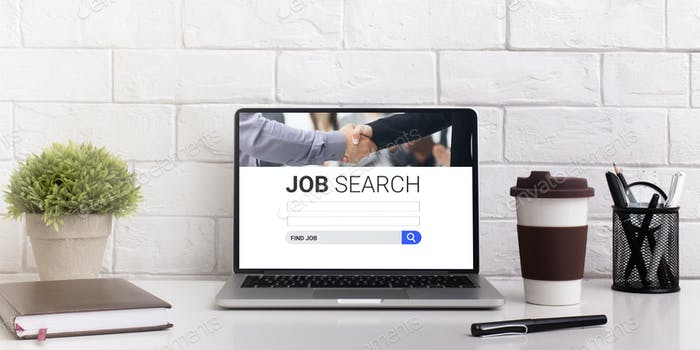 Pc on the desk with job search engine on display