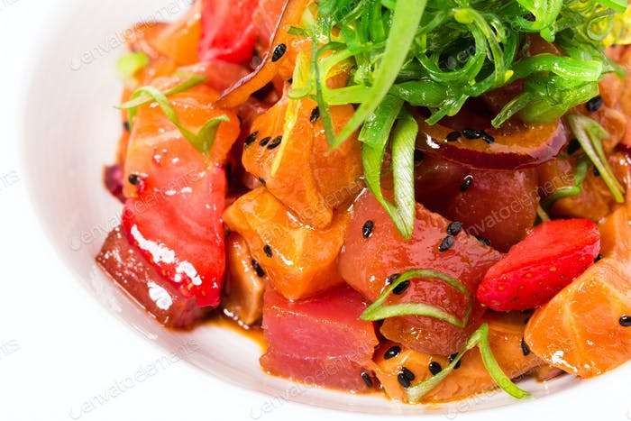 Delicious salmon salad with seaweed and strawberry.
