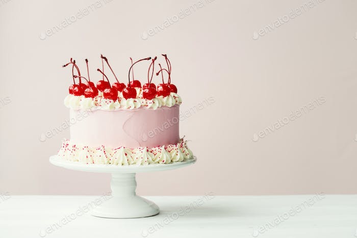 Cake decorated with maraschino cherries