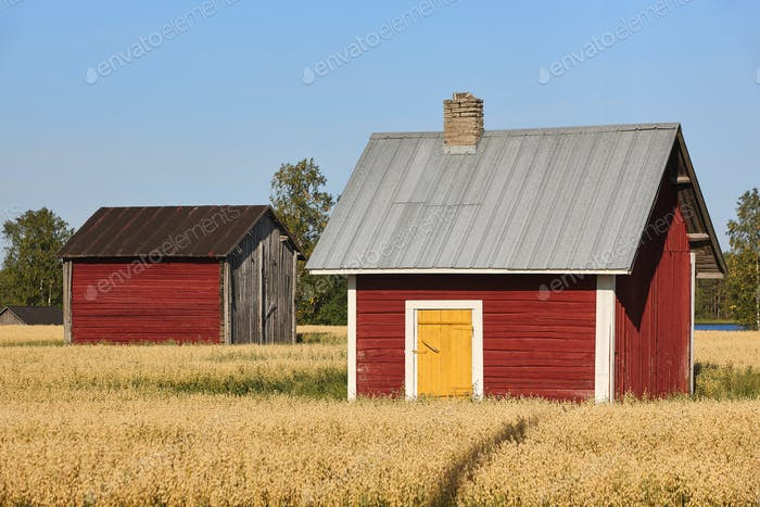 Traditional finnish red wooden farms in the countryside. Finland