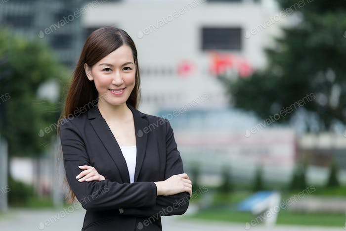 Confident Businesswoman armed crossed