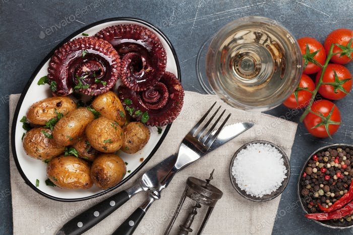 Grilled octopus with small potatoes and wine