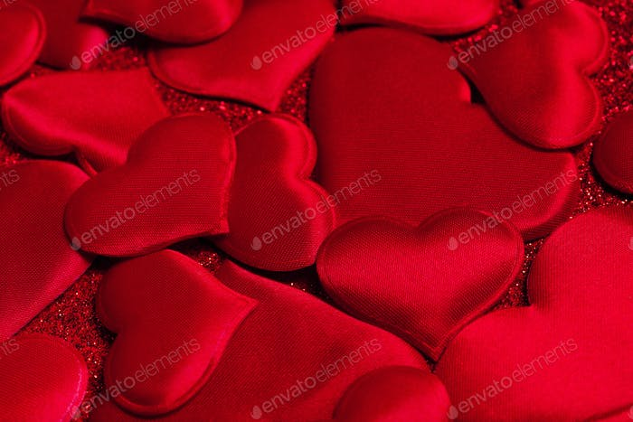 Festive Background of Red Satin Hearts
