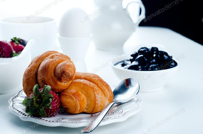 breakfast with eggs, fresh croissants,