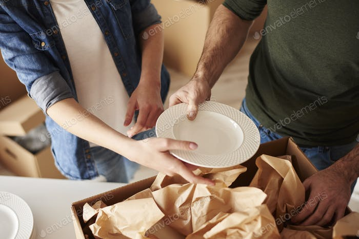 Packing dinnerware to the boxes