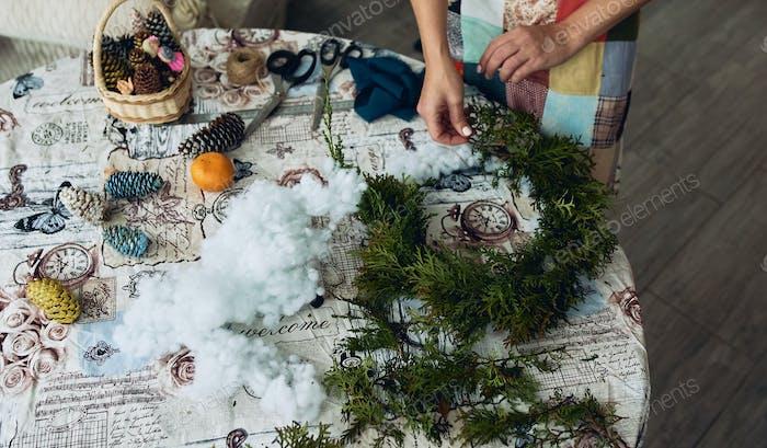 Handmade Christmas wreath. Making Christmas decorations.