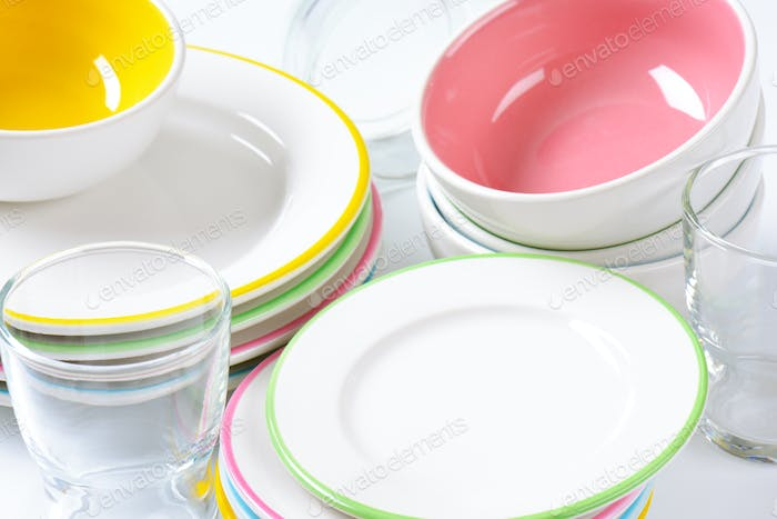 set of rimmed plates, bowls and glasses