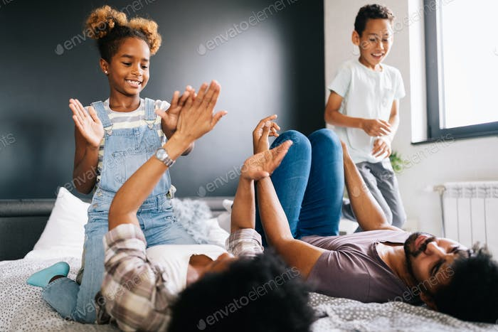 Young family being playful and spending fun time together at home