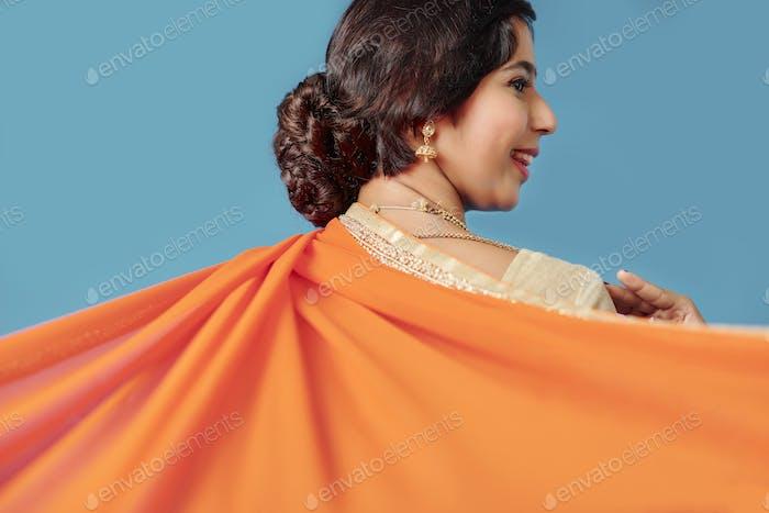 Woman dancing in silk sari