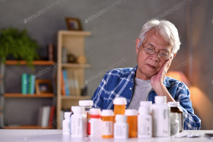 Senior man with pill