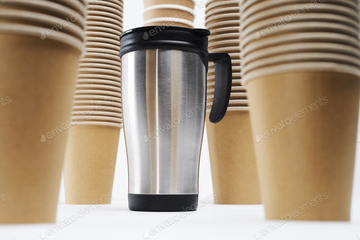 Vacuum bottle and stack of disposable mugs