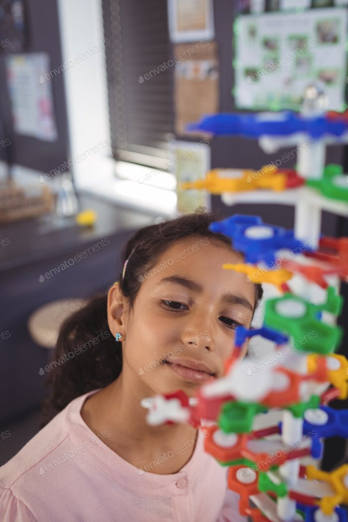Elementary student looking at model in classroom