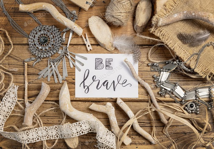 Card with the text BE BRAVE with bohemian decorations around