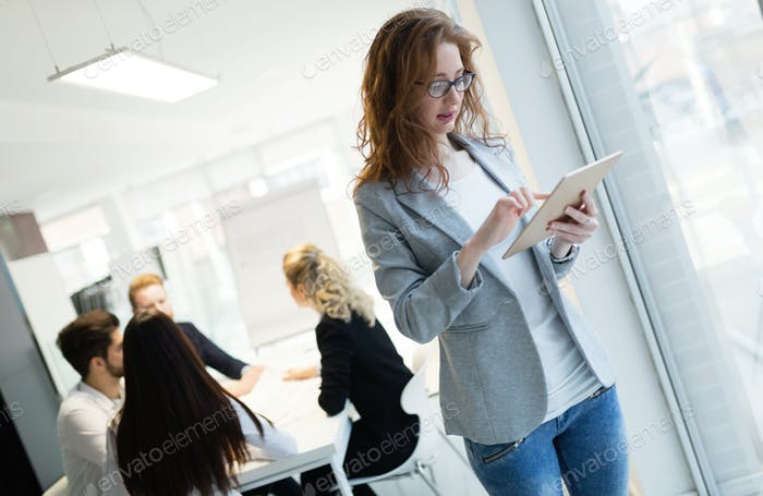 Elegant smart businesswoman in company office