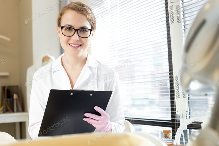 Smiling Cosmetologist Holding Clipboard