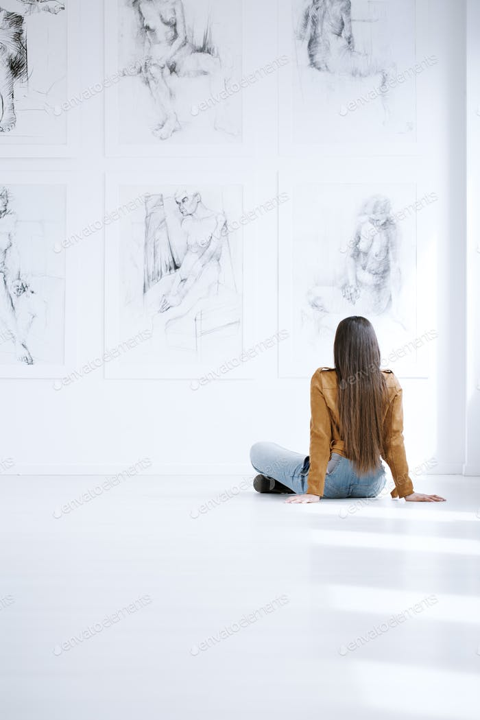 Woman looking at drawing collection