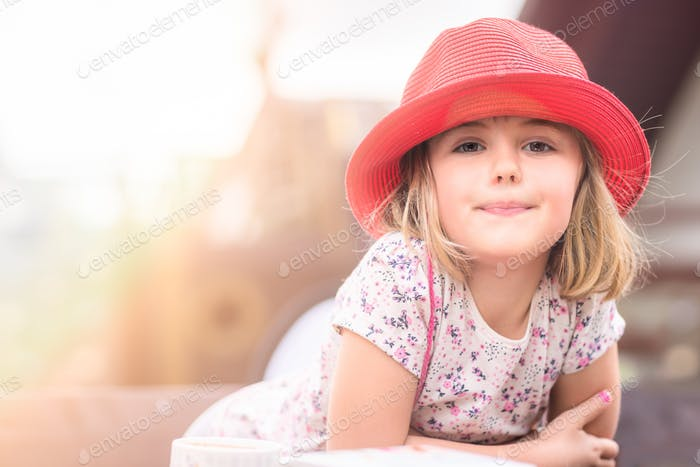 Cute little girl with a red hat
