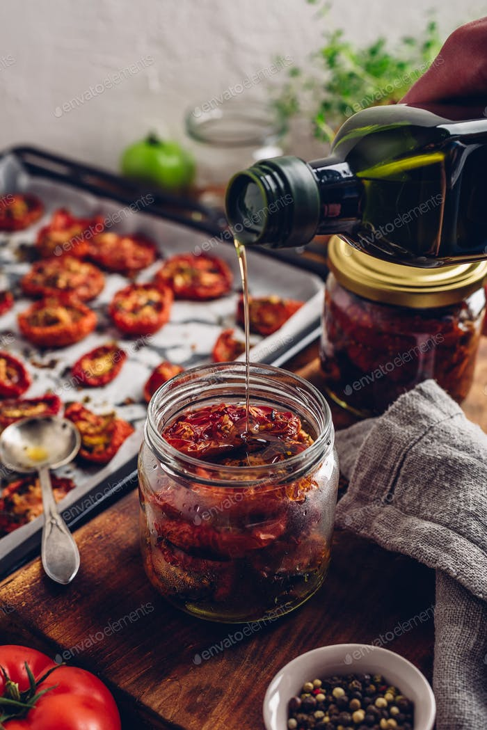 Coating of Sun Dried Tomatoes with Olive Oil in a Jar