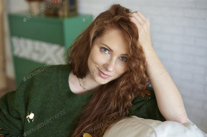 Portrait of smiling, red haired girl with freckles