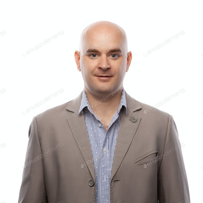 attractive bald man in a beige jacket on a white background isolated