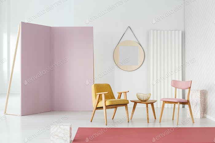 Pastel seats and coffee table in a photo studio interior with la