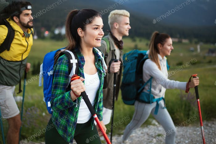 Hiking with friends is so fun. Group of young people with backpacks walking together