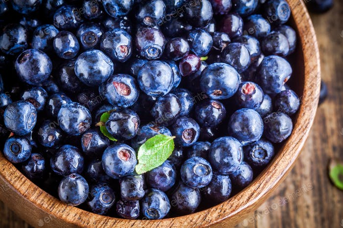 Fresh organic blueberries in a bowl closeup