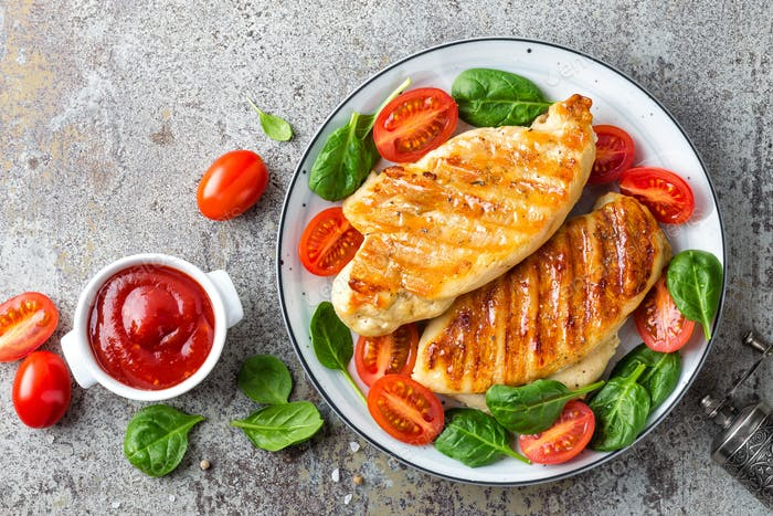 Chicken breast or fillet, poultry meat grilled and fresh vegetable salad