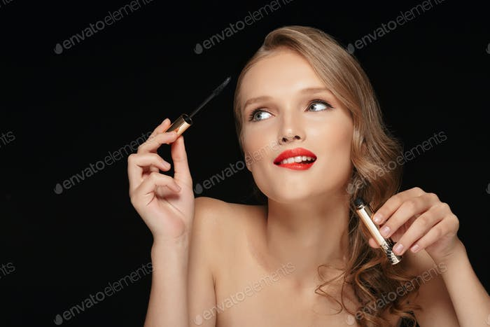 Portrait of young beautiful lady with wavy hair and red lips hol
