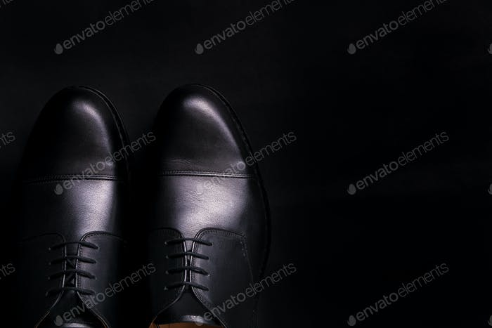 Black oxford shoes on  background. Top view. Copy space.