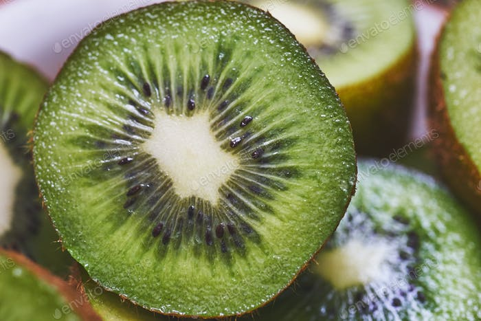 closeup fresh tropical juicy kiwi slices.