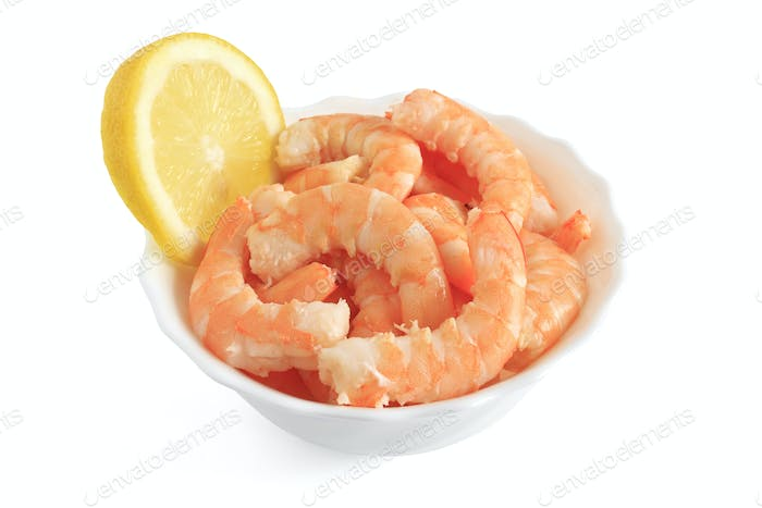 bowl with shrimps and lemon