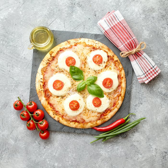 Homemade pizza with tomatoes, mozzarella