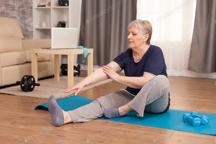 Senior woman practicing fitness at home