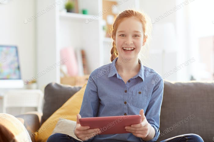 Happy Teenage Girl Holding Tablet