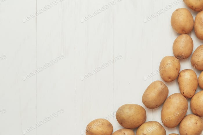Agricultural rustic background - potato harvest on a wooden white table