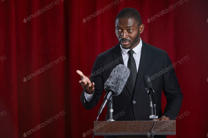 African-American Public Speaker on Stage