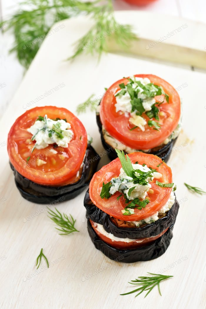 Appetizer eggplant with tomatoes and cheese, close up view