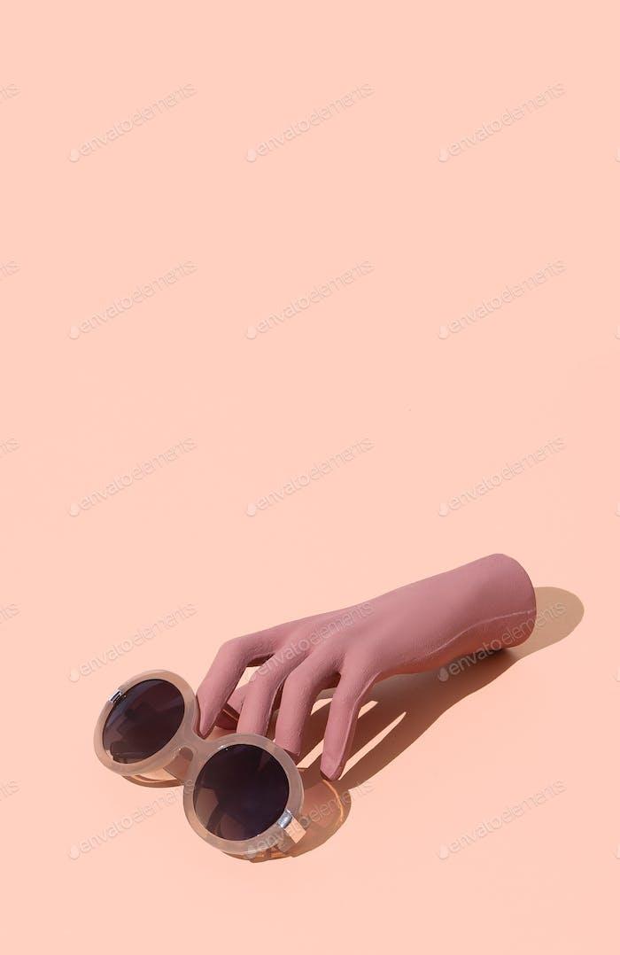 Stylish sunglasses on beige background. Minimal isometric design. Sale and shopping