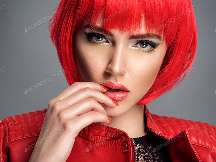 Beautiful sexy woman with bright red bob hairstyle. Fashion  model.