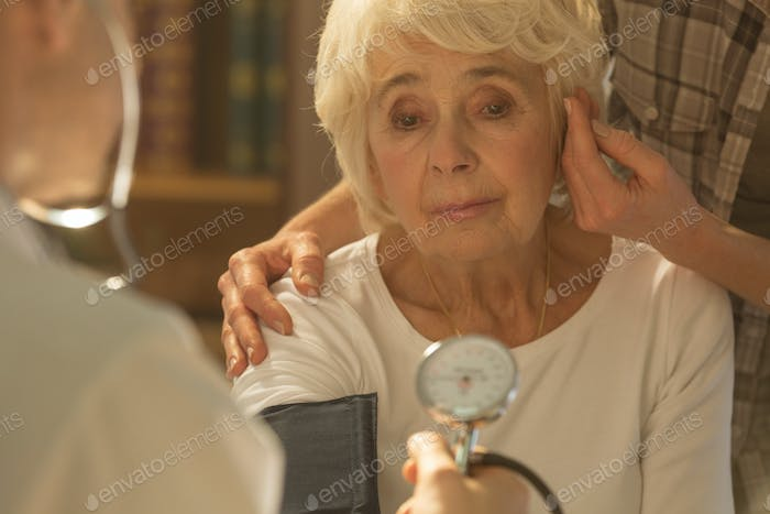 Worried senior woman and doctor