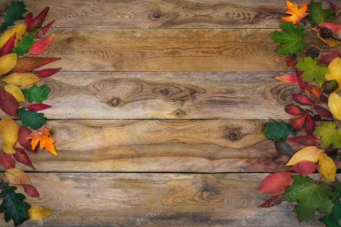 Thanksgiving background with leaves on old wooden table