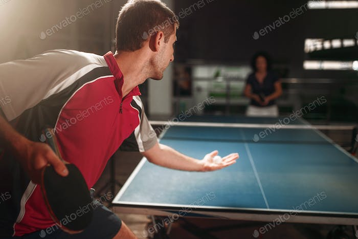 Table tennis, male player with racket and ball