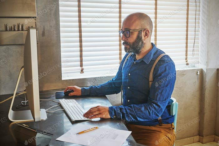 Businessman working on laptop for new architectural project.