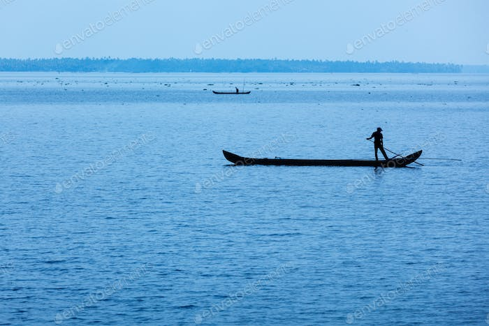 Man on boat. Kerala, India