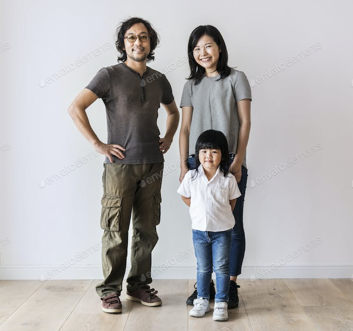 Cheerful Asian family move to new house