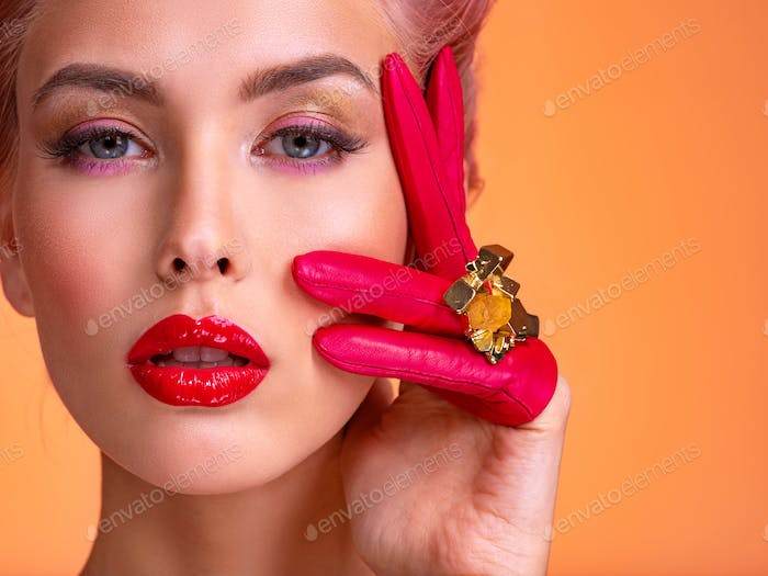 Beautiful woman with bright colored makeup. Fashionable concept.