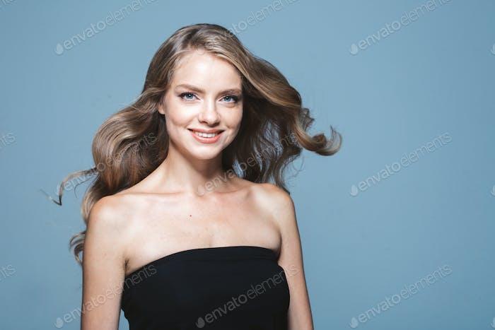 Woman casual studio portrait long blonde hair natural make