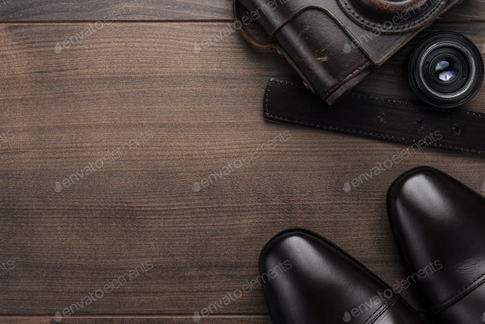 Brown Shoes And Film Camera Background